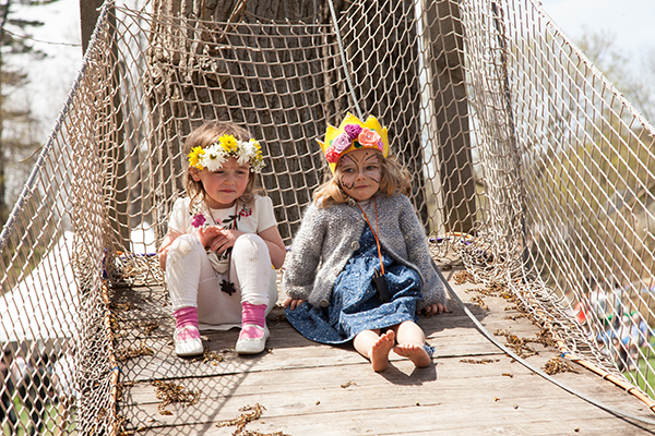 Girls wearing flower crowns during May Day Celebration