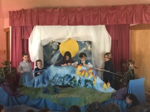 Six students from the Little Acorn Troupe of the Magical Puppet Tree performing The Rainbow