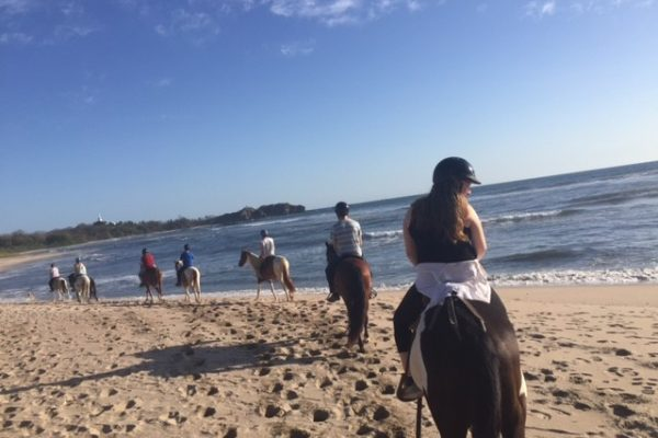Twelfth grade service trip riding horses on the beach