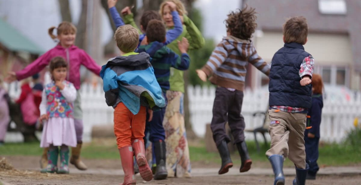 Children jumping and playing outside