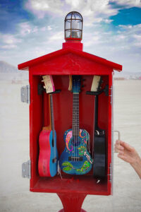 """In Case: A Uke,"" whimsically re-imagined civic infrastructure that could address an individual's internal experience, not just a community's external needs. Taking the form of several classic red Emergency Call Boxes, each one was outfitted with ready-to-play, hand-painted ukuleles and installed at the Burning Man festival in 2017"